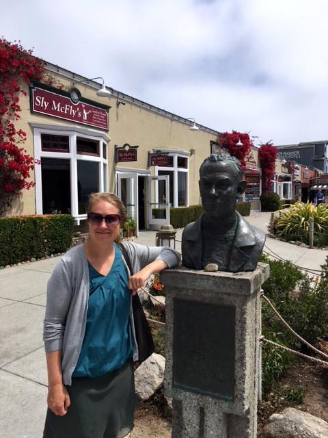 Photo of Jenny Hettne by statue of John Steinbeck.